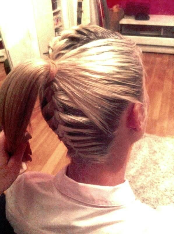 French Braid in back and on top with a ponytail in back by Steffi Micu.