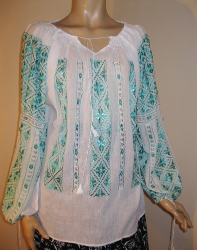 Turquoise silk embroidery on a fabulous Romanian blouse !