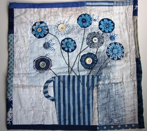 by Mandy Pattullo. Hand sewn applique and stitch on vintage, recycled fabrics.