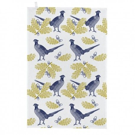 White cotton tea towel hand printed with navy pheasants and green oak leaves. 50cm x 70cm 100% cotton Wash at 40 degrees Made in Great Britain
