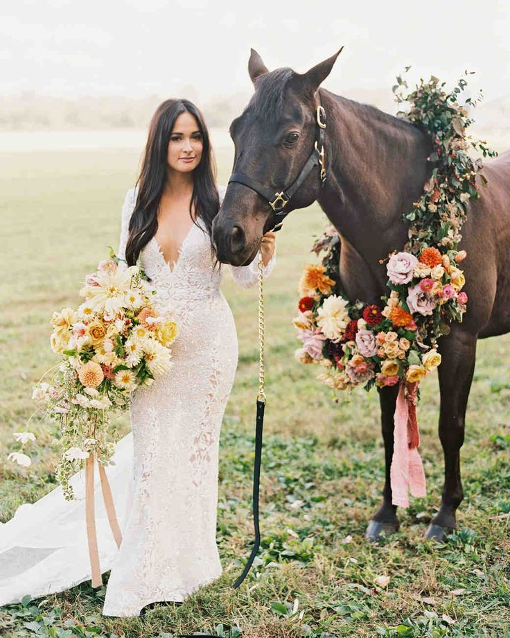 Kacey Musgraves and Ruston Kelly's Charming Tennessee Wedding | Martha Stewart Weddings - Kacey wore a lace gown by Berta; her horse, a floral wreath made by Bows + Arrows Flowers. The bride also carried a lush, trailing bouquet of dahlias and garden roses tied with a velvet ribbon. #weddingbouquets #weddingdresses #wedding #weddingideas