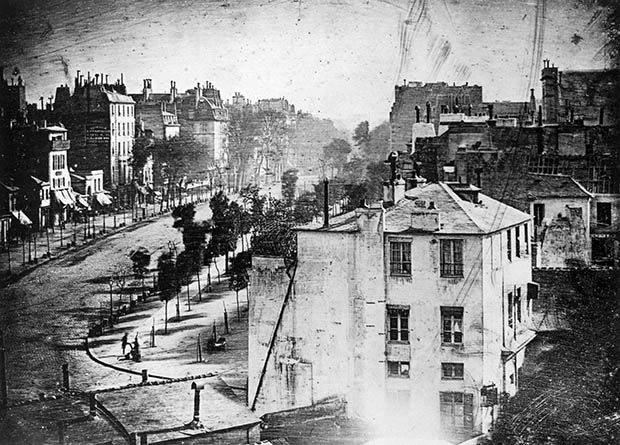 Paris, 1838. The first photograph to ever have a human being in it. The exposure of the photo was over 10 minutes, so street traffic couldn't be captured. The one person in this picture was standing still through those 10 minutes because he was getting his shoes polished. Thus, this lone figure makes history.