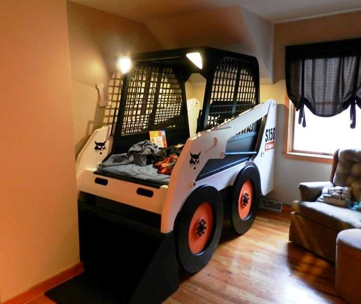 With headlights and a dome light that turn on using a real Bobcat ignition and key, John M. certainly outdid himself on this S150 skid-steer loader replica bed for his son.