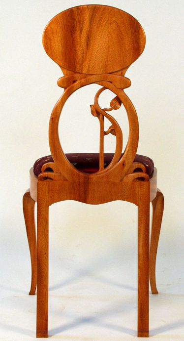 Art Nouveau chair ~ Carved mahogany with silk upholstery.