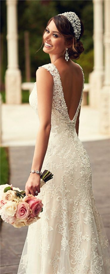 Take advantage of your indoor (air conditioned) venue by going for a slightly fuller skirt without fear! Lace goes great with a garden venue and a touch of sparkle adds the elegance!