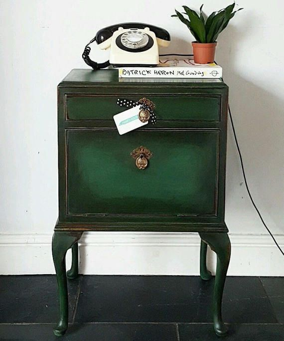 This item is RESERVED until further notice! A gorgeous vintage bedside cabinet, probably dating somewhere between the 1930s to the 1950s. A very pretty piece sitting on cabriole legs and a rare find; It has a useful drawer and a cupboard underneath with a pull down door, features the original brass drop handles which are stunning. Painted in Annie Sloans new colour Amsterdam Green Chalk Paint which is a deep racing green; then waxed with Annie Sloan black wax to intensify the colour and…