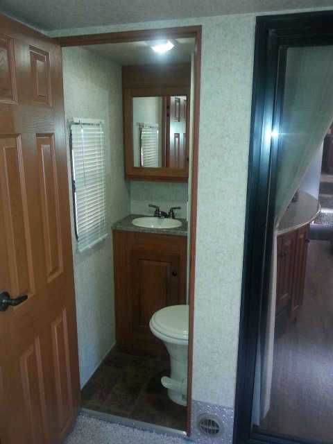 2011 Used Heartland Cyclone 3800 Toy Hauler in Michigan MI.Recreational Vehicle, rv, ***** NEW LOWER PRICE - $37,900 ***** 2011 Heartland Cyclone 3800, Lightly used 43' Toy Hauler in Excellent Condition, White High Gloss Exterior w/Blue Graphics, 3 Slides, Sleeps 10, Electric Awning, Cummins Onan 5,500 generator, Hydraulic Front Landing Gear, Electric Rear jacks, 32 LCD TV in Living Room, Electric Fireplace. AM/FM Stereo w/CD/DVD, Jensen Speakers , 3 Fantastic Vents with rain Sensors…