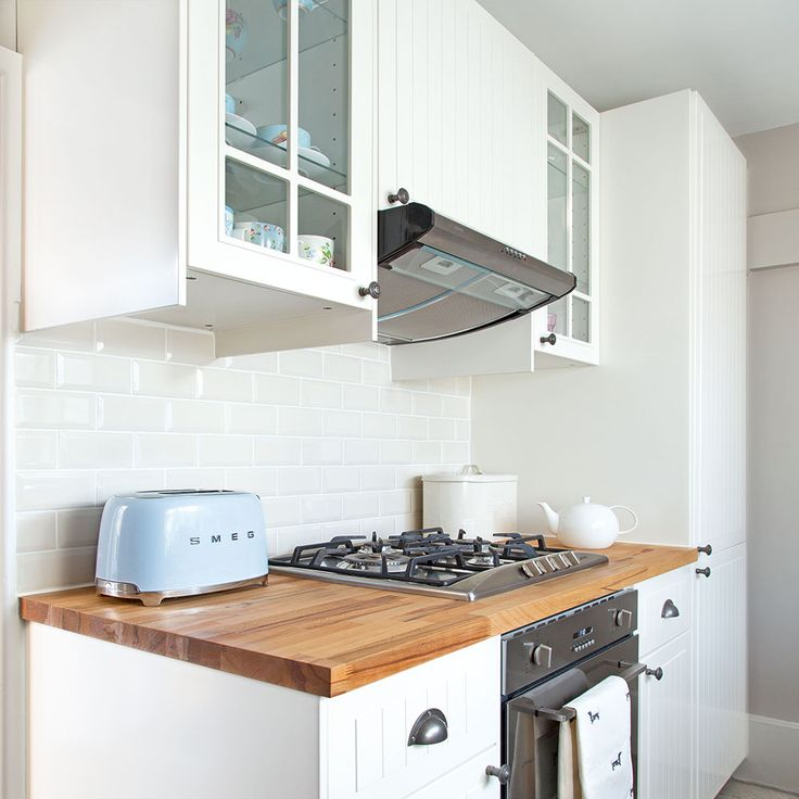 Small white kitchen with wood worktops