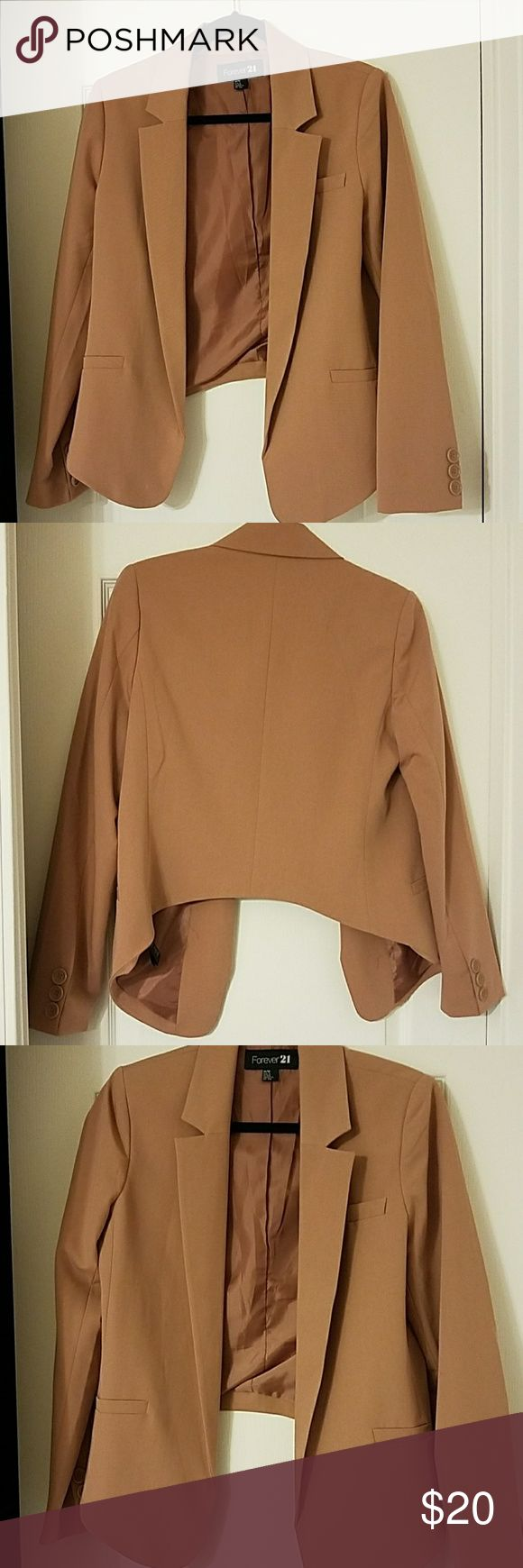 Peach blazer Perfect condition peach blazer or can pass as rust . It's longer in the front and shorter in the back. Perfect for any occasion. Forever 21 Jackets & Coats Blazers