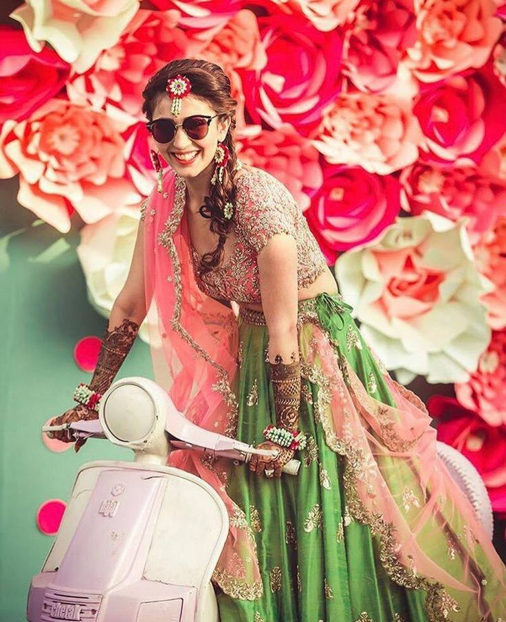 This  ARBride is taking bridal swag to another level while rolling into her wedding in her adorable pink ride.  04 January 2017