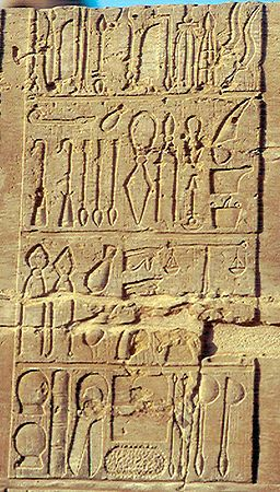 Ancient Egyptian medical instruments-including scalpels,lances,suction cups,scales,& what seems to be forceps.Egyptians were adept at suturing wounds,& used antiseptic herbal poultrices,honey,& even competing organisms(live yeasts,bread molds)-to combat infections.