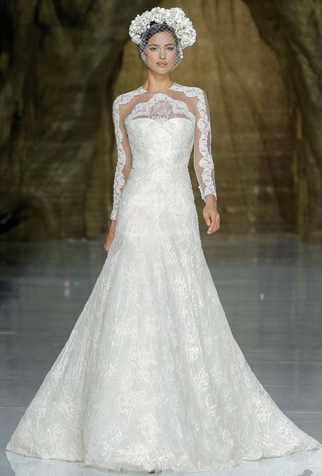 """Brides.com: Our Favorite Lace Wedding Dresses from the Bridal Runways. """"Yana"""" Chantilly lace and tulle A-line wedding dress with long sleeves and a high neckline, Pronovias  See more Pronovias wedding dresses"""
