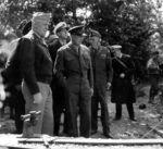 "Gen ""Hap"" Arnold, Gen Dwight Eisenhower, Adm Ernest King (white cap), and Gen George Marshall visit the guns moved from Pt du Hoc, Normandy,..."