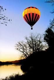 watch the sunset in a hot air balloon