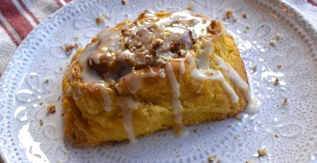 Pumpkin biscuit cinnamon buns with orange vanilla bean glaze