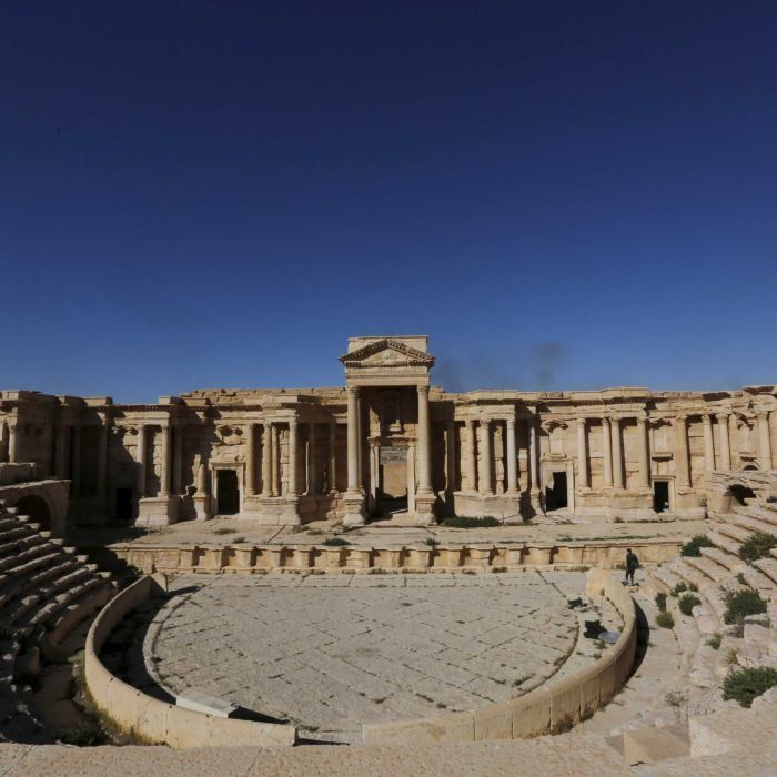 Islamic State militants destroy one of the most famous monuments in Palmyra, the Tetrapylon, Syria's antiquities chief says.