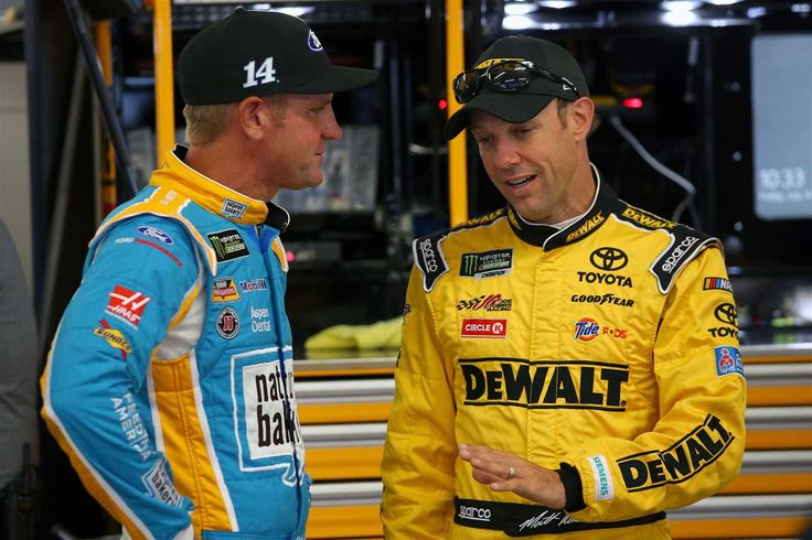 At-track photos: New Hampshire weekend Sunday, July 16, 2017 Matt Kenseth, driver of the No. 20 DEWALT Flexvolt Toyota, speaks with Clint Bowyer, driver of the No. 14 Nature's Bakery/Feeding America Ford, in the garage area during practice for the Monster Energy NASCAR Cup Series Overton's 301 at New Hampshire Motor Speedway on Friday. Photo Credit: Chris Trotman | Getty Images Photo: 55 / 70