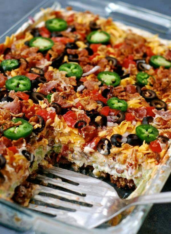 LAYERED TACO SALAD....made in a 9x13 cake pan!! This is soooooo good & perfect for potlucks/dinner!  Recipe...http://chindeep.com/2016/02/23/layered-taco-salad-in-a-cake-pan/
