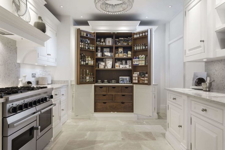 With special hinges that allow them to be opened to 180 degrees, bespoke pantry cupboards by Tom Howley make finding kitchen essentials a breeze.