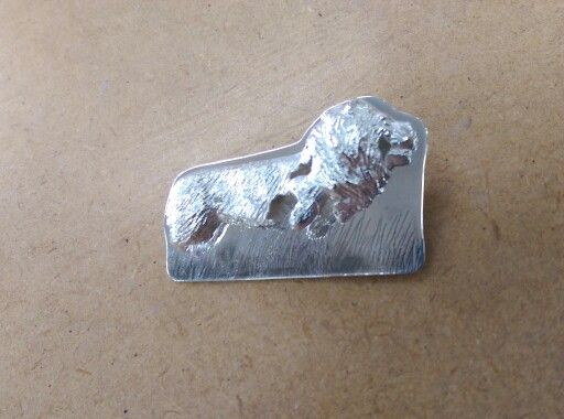 Sterling silver lion brooch