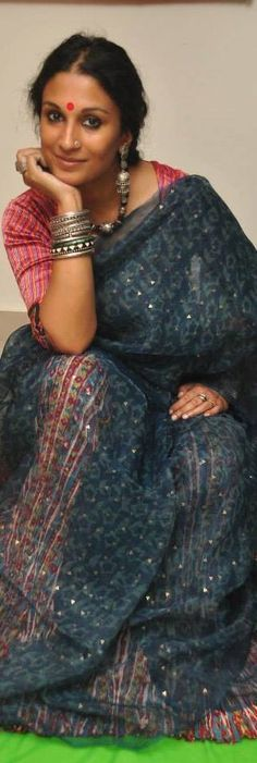 Painter Dithi Mukherjee in an amazing hand loom saree. Can somebody tell me what saree this is? Looks like a blue jamdani worn on a multicolour petticoat but not sure.- original pin by @webjournal