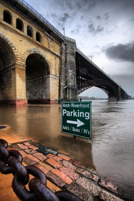 Intense image of the Mississippi River during flooding. The St. Louis Landing under the Eads Bridge.