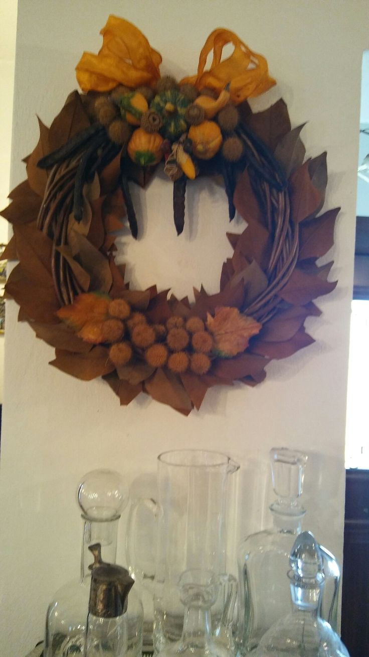 I made this wreath with magnolia leaves and some ceramic tiny pumpkins.