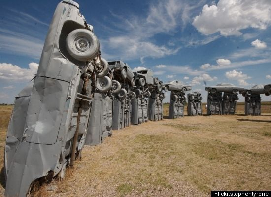 Carhenge is a replica of England's Stonehenge located near the city of Alliance, Nebraska on the High Plains. Instead of being built with large standing stones, as is the case with the original Stonehenge, Carhenge is formed from vintage American automobiles, all covered with gray spray paint. Built by Jim Reinders, it was dedicated at the June 1987 summer solstice. In 2006, a visitor center was constructed to serve the site.