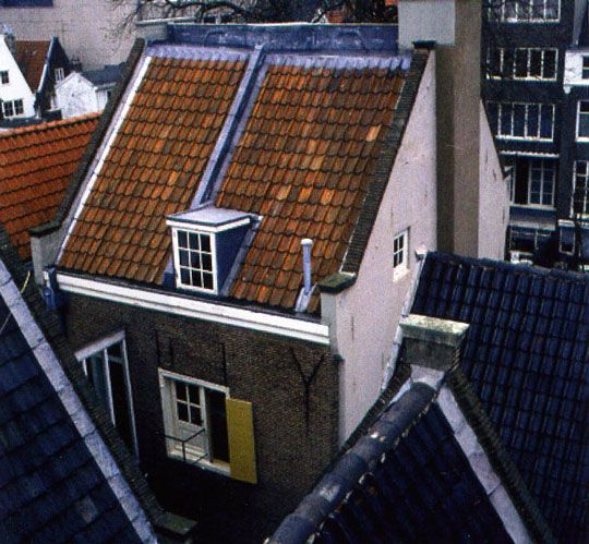 Outside back view of the top floor and attic of the house where Anne frank's family went into hiding.