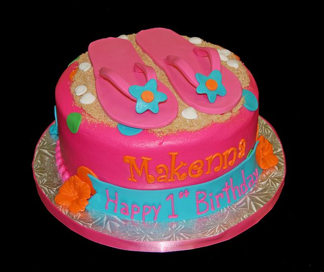 Bright colored luau themed first birthday cake with flip flops by Simply Sweets, via Flickr