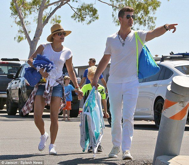 Robin Thicke and ex-wife Paula Patton reunite to spend time with their five year old son Julian - http://www.nollywoodfreaks.com/robin-thicke-and-ex-wife-paula-patton-reunite/
