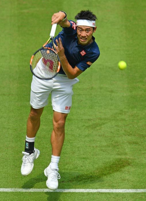 Kei Nishikori serves against Lucas Pouille in a match at Gerry Weber Open on June 13, 2016 in Halle, Germany...