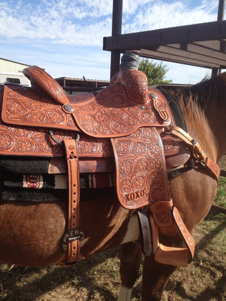 Larry Coats premier team roping saddle..only XOXO made.  Custom buckles and conches by Campbell bits n spurs, Amarillo, TX.