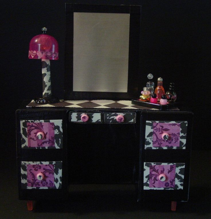 I created all of the bedroom furnishings from recycled food boxes, duct tape, scrapbook paper, spray paint can lids, various caps, beads and push pins. The middle drawers in Spectra and Cupids'...