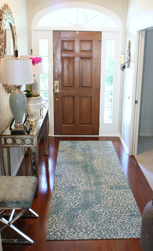 Entryway with decorating tip: Teal animal print rug is carpet squares from FLOR that are attached with the FLOR adhesives. The Creativity Exchange