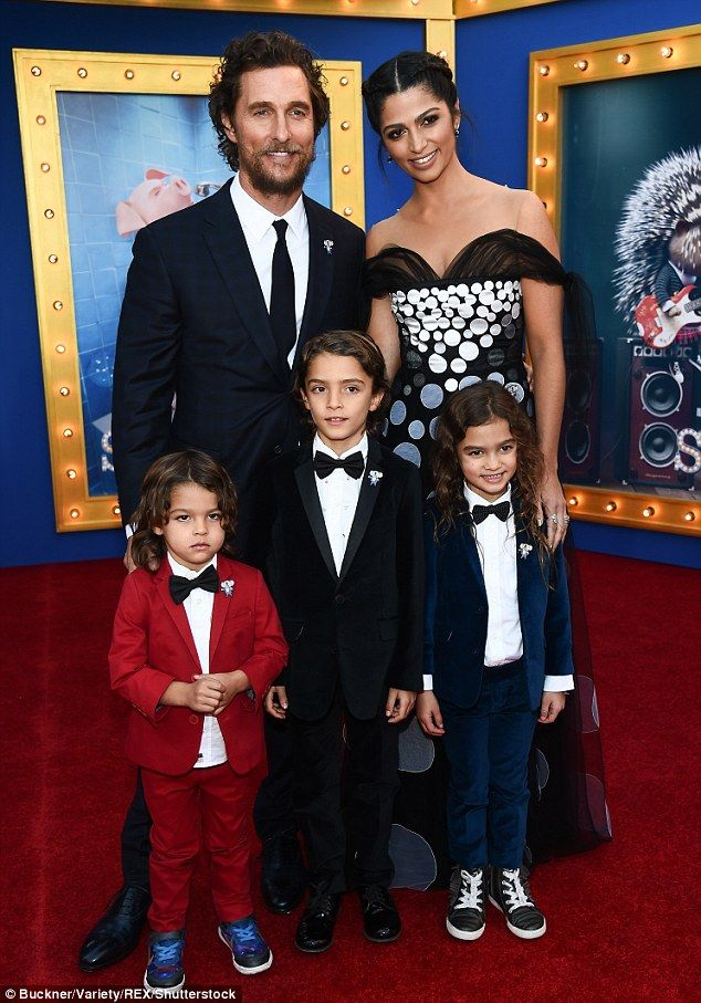 Tuxedo-clad kids: The eccentric Texan shares lavish homes in Malibu and Austin with the Brazilian 34-year-old and their three children - Livingston, 3; Levi, 8; and Vida, 6