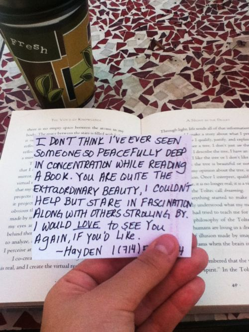 She was at an old cafe by the beach alone and got up to use the restroom and buy a croissant. When she returned this was in her book.
