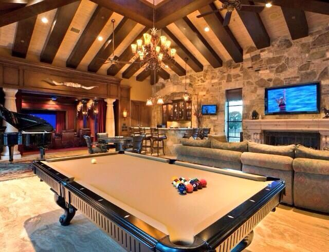 I like this overall layout. Going to need more TVs however for multiple football games. Couch color will match dark brown panels on the roof. I don't like the chandelier.