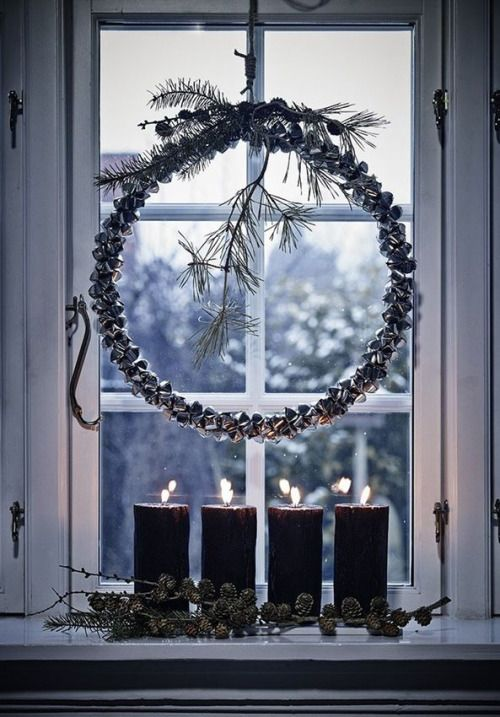 Christmas wreath shines brightly next to the window and the contrast of the black candle make this all so wonderful!