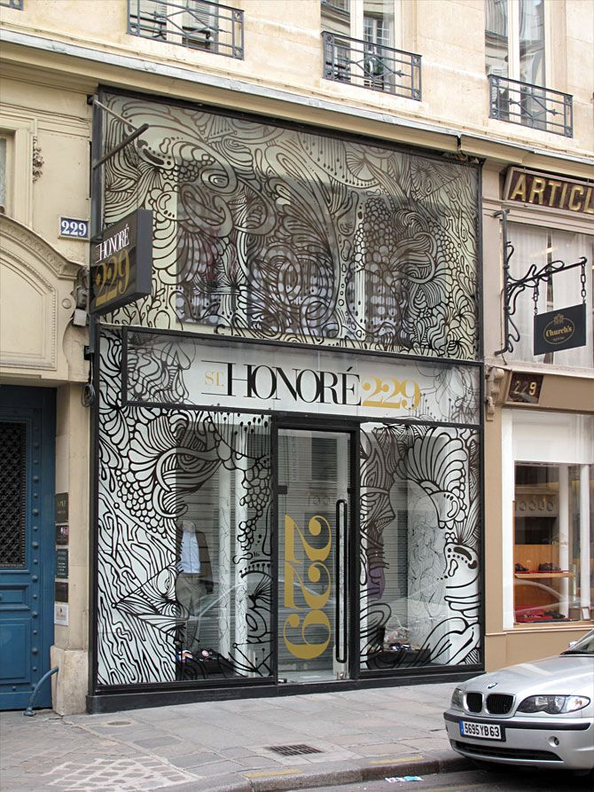 perhaps the building's facade wasn't up to snuff, why not add an artstic treatment like this shop on the famed Rue St. Honoré in Paris?
