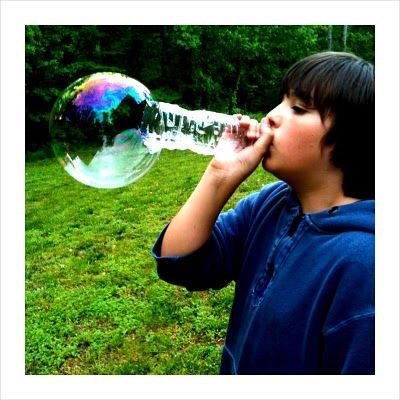 Blow big bubbles with a water bottle