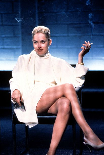 Basic Instinct, Sharon Stone | In Basic Instinct (1992) It was the leg-crossing heard 'round the world. With one shift of her not-inconsequential gams, Sharon Stone became a star. —…