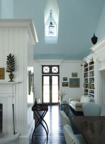 White walls, pale blue ceiling, wood floors. Incredible doors and sitting area.