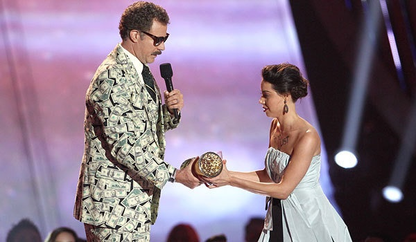 Viewers of this year's MTV Movie Awards were unsure whether or not Will Ferrell and Aubrey Plaza planned a stunt since the awards show has a history of ridiculous antics. Either way, the stunt has become one of the most talked about moments of this year's show and Plaza gained media attention of her upcoming movie, since the title was written across her chest.  http://www.latimes.com/entertainment/tv/showtracker/la-et-st-mtv-movie-awards-aubrey-plaza-stunt-20130415,0,7917517.story