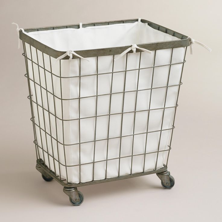 "Ellie Rolling Hamper from World Market. Made of metal in an antique finish with a removable 100% polyester liner. 20""W x 15""L x 23""H. $99.99"