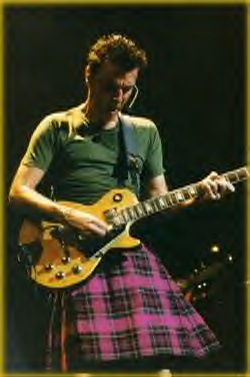 "David Byrne, Scottish-born lead singer and guitarist, formerly of the ""Talking Heads"", Burning Down The House in his kilt."