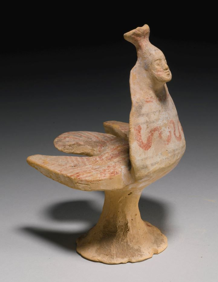 Greek terracotta figure of a siren, Boeotian, circa 550-500 B.C. Support with splayed foot, fan-shaped tail, outspread wings, triangular neck, and flaring polos, the details painted red and black over gesso, 16.5 cm high. Private collection