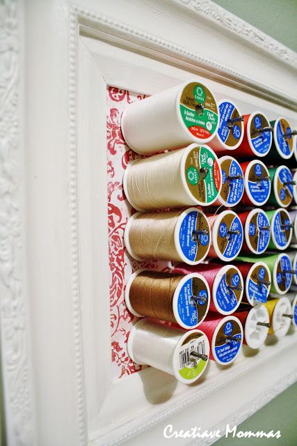 Creative Mommas: Thread Organization ~ cute idea but I'd make it bigger and let more of the pretty paper {or fabric} behind the spools show more ... and use longer nails so I can put the bobbin on the same peg!