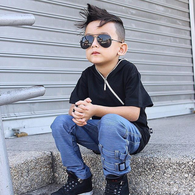 Weekends this cool! :sunglasses: Handsome Karam  wears The Edge hooded tee in black paired nicely with the M-502 ultra soft denim pants featuring straps! :point_right: perfect time to shop the coolest streetwear available in sizes 0-6 years :point_right: www.mischiefandco.com :shopping_bags: . . . . #mischiefandco #weekendfashion #kidsfashion #kidsclothes #kidsclothing #kidsstreetfashion #kidsstreetwear #toddlerfashion #toddlerstyle #pinterest #toddlersofig #influencer  #kidsootd…
