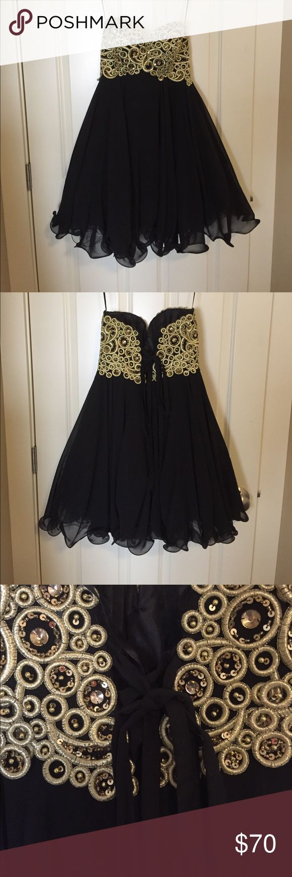 ❤️FP❤️ Short Black and Gold Prom/Homecoming Dress Be the belle of the ball in this gorgeous dress! All gold jewels and sequins are intact, this dress was only worn a few times. Features a corset lace up in the back, this does not come with the piece of black fabric for the corset, meaning that your skin will show when it is laced up. Does come with the black lace up tie. Bundle to save even more! Let me know if you have any questions, happy poshing ❤️ Dresses Prom